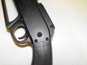 Three Screws Each Side Securing The Stock